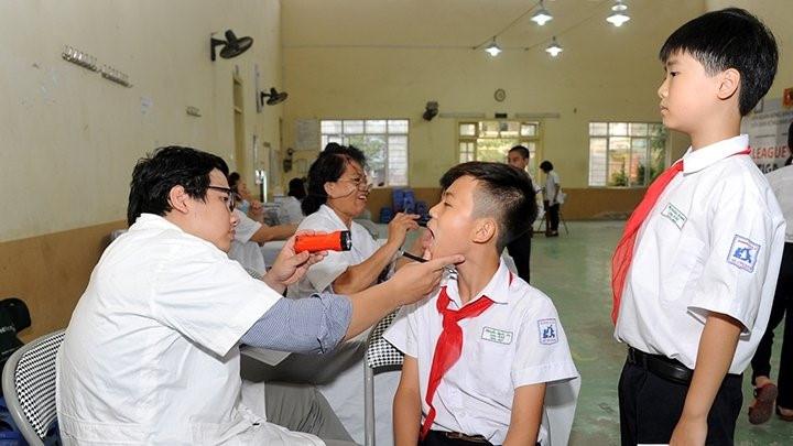 Thu bảo hiểm y tế ở trường học: Giáo viên chỉ làm vì trách nhiệm
